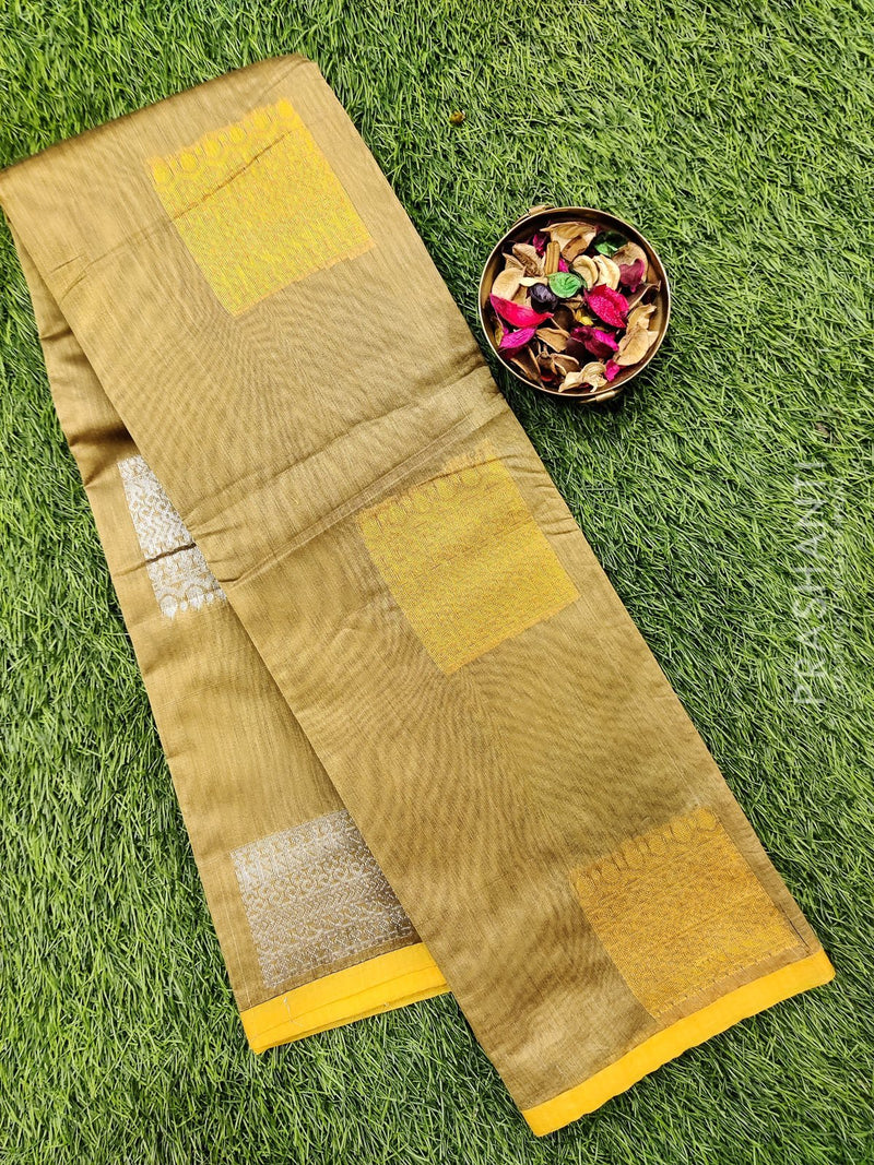 South kota saree beige and yellow with simple border and body buttas