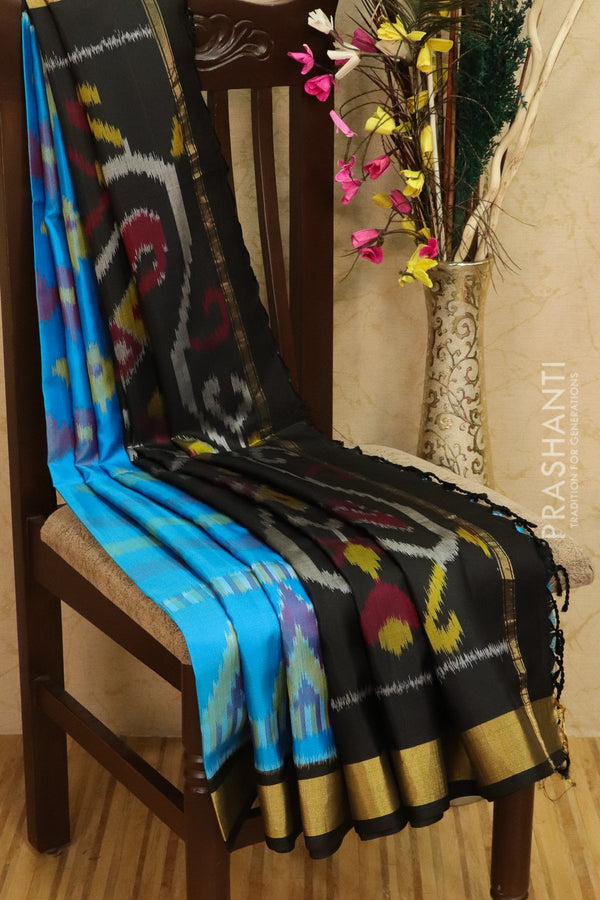 Ikkat soft silk saree cs blue and black with kaddi zari border and ikkat weaves