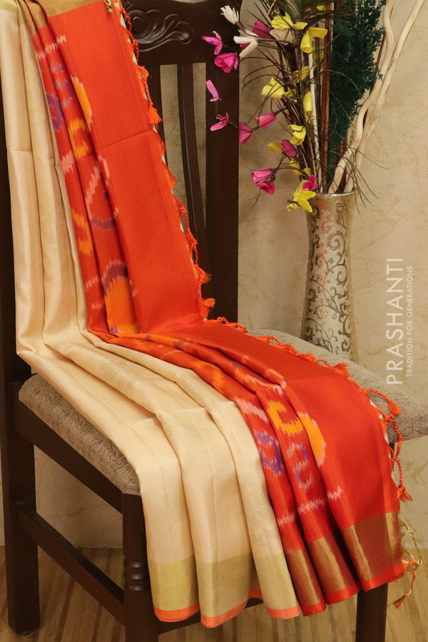 Ikkat soft silk saree off white and orange with kaddi zari border and ikkat weaves