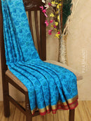 Pure Mysore Crepe silk saree light blue and maroon with allover prints and self emboss with golden zari border