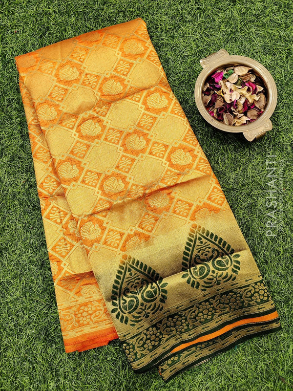 Dola Silk saree orange and dark green with all over brocade weaves and rich zari border