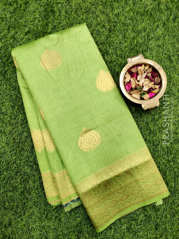 Dola Silk saree light green with zari buttas and rich zari border