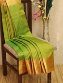 Pure kanjivaram silk saree light green and pink with allover self emboss and zari buttas with zari woven border