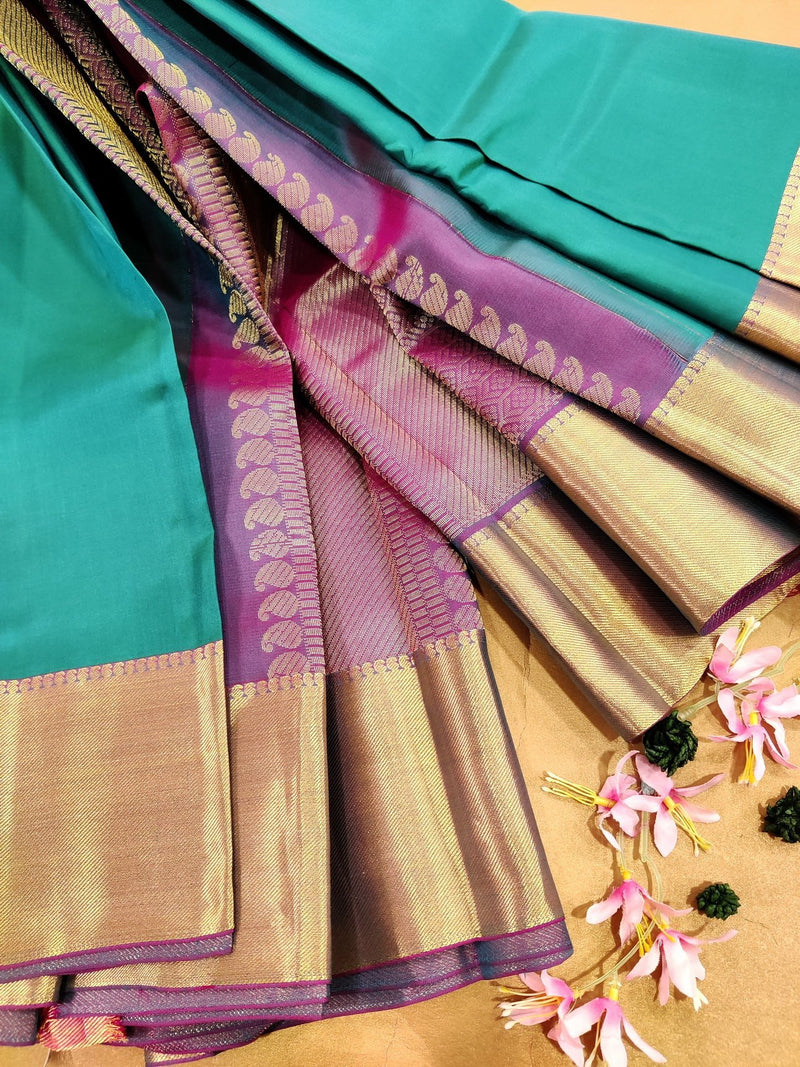 Pure kanjivaram silk saree green and purple with plain body and rich zari border