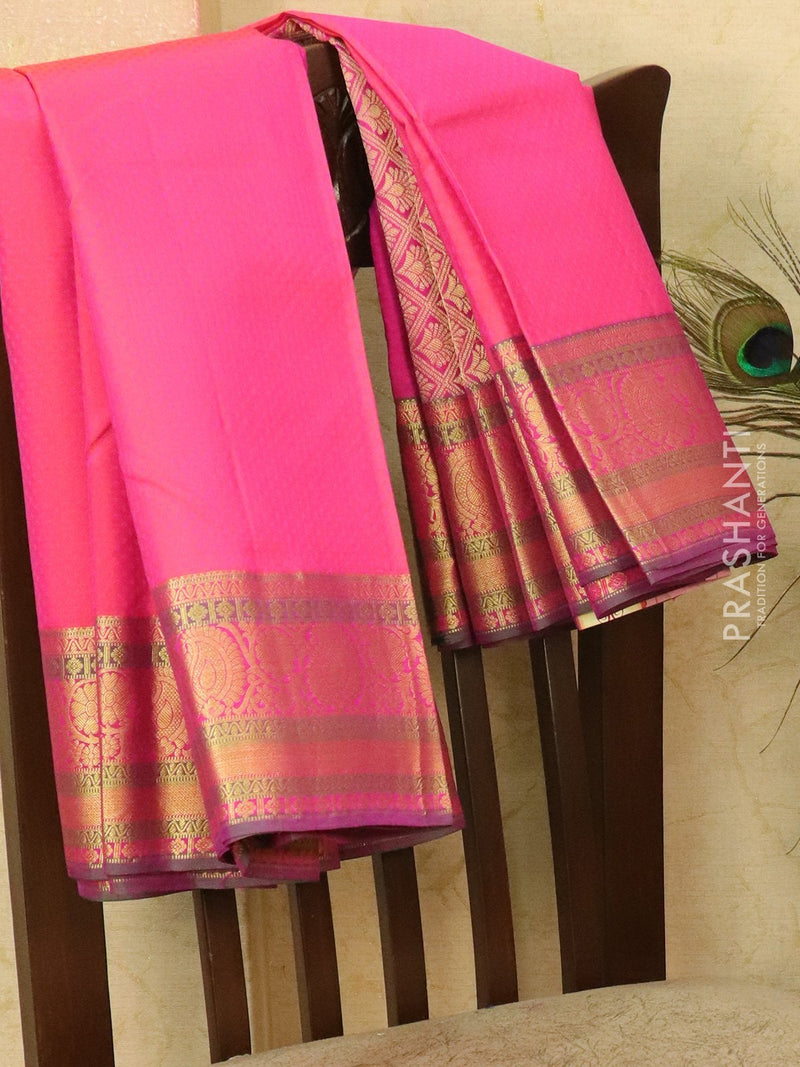 Pure kanjivaram silk saree pink and dual shade of green with allover self emboss and golden zari border