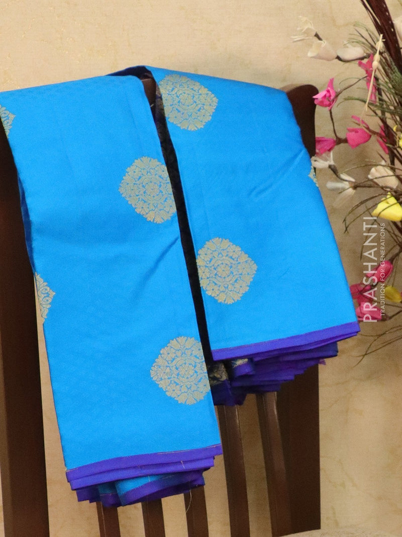 Pure kanjivaram silk saree cs blue and violet with allover self emboss and zari buttas in half and half style