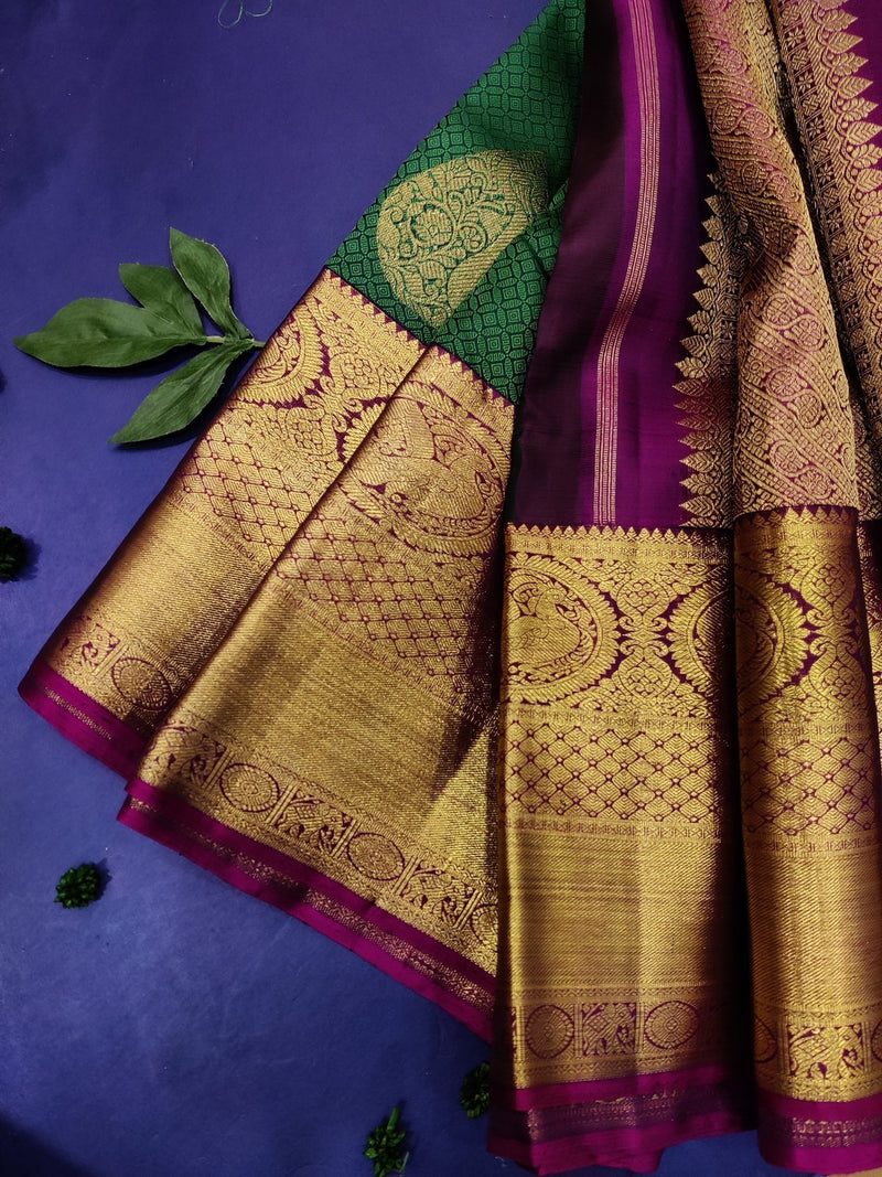 Pure Kanjivaram silk saree green and magenta pink with allover self emboss and buttas with rich pure zari border