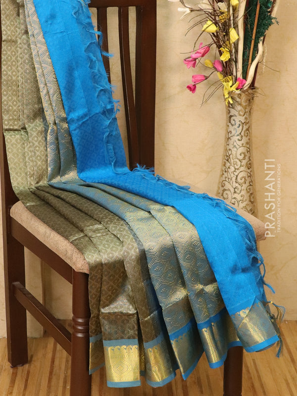 Silk Cotton saree grey and cs blue with allover self emboss Jacquard and rich korvai border