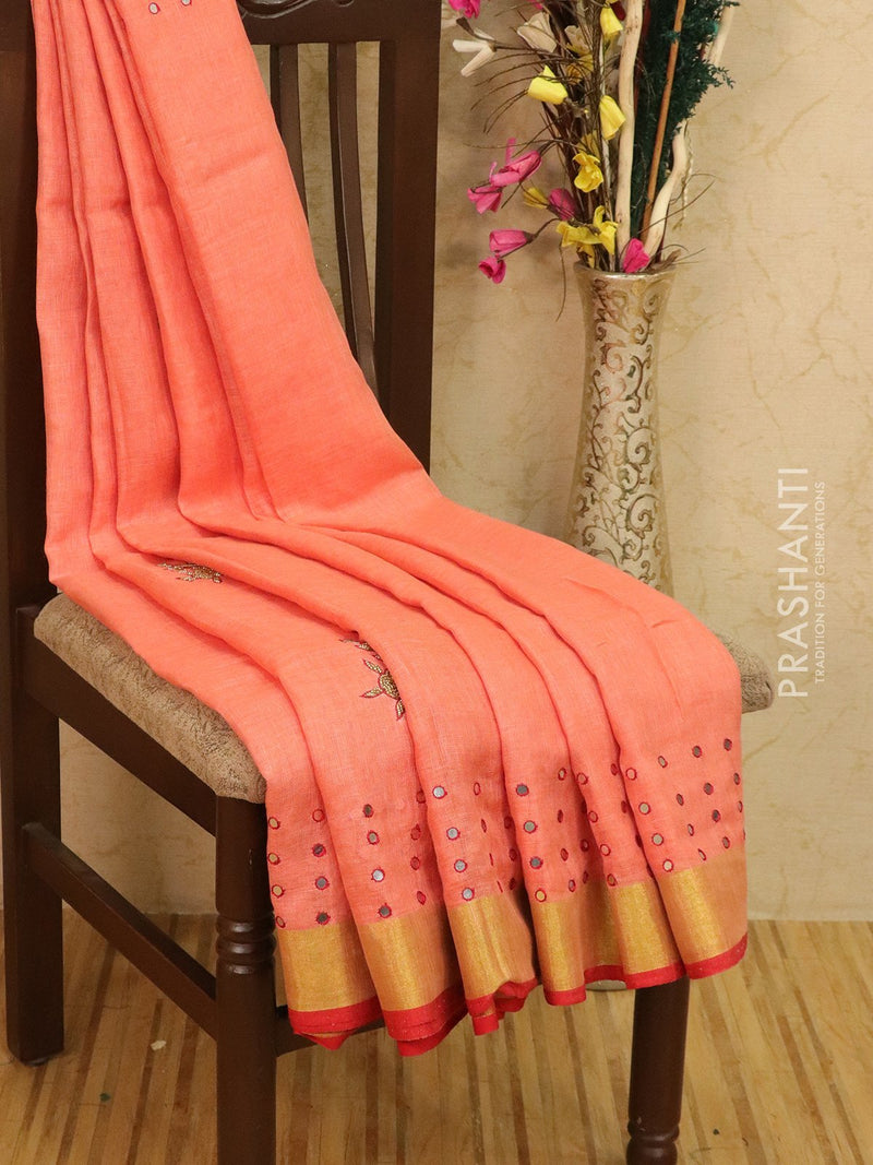 Linen tissue hand embroided saree peach with mirror work and silver zari border