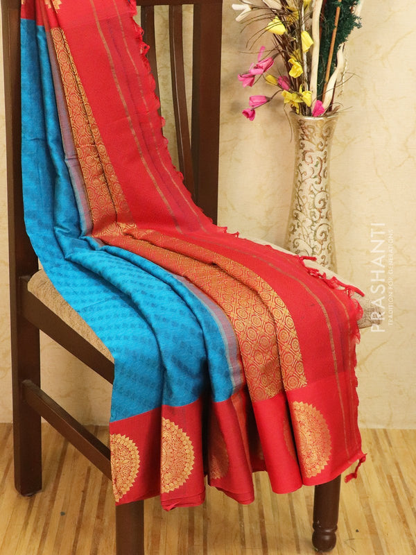 Semi silk saree blue and red with self emboss and zari butta border