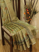Pure tussar silk saree pista green with allover floral prints and simple border