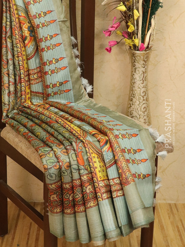 Pure tussar silk saree pastel blue with allover floral prints and simple border
