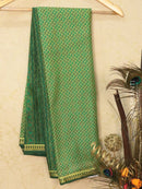 Semi crepe saree green with all over prints and zari border