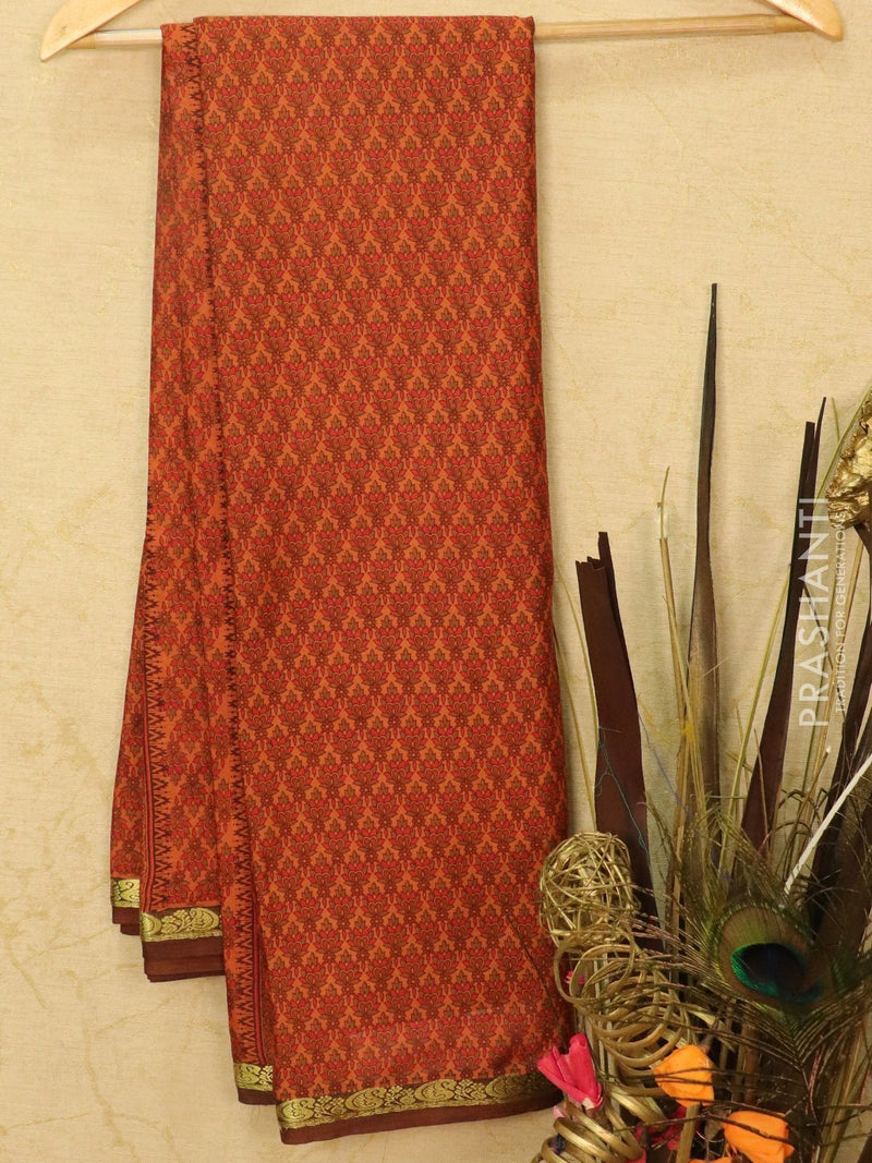 Semi crepe saree rust and brown with all over prints and zari border