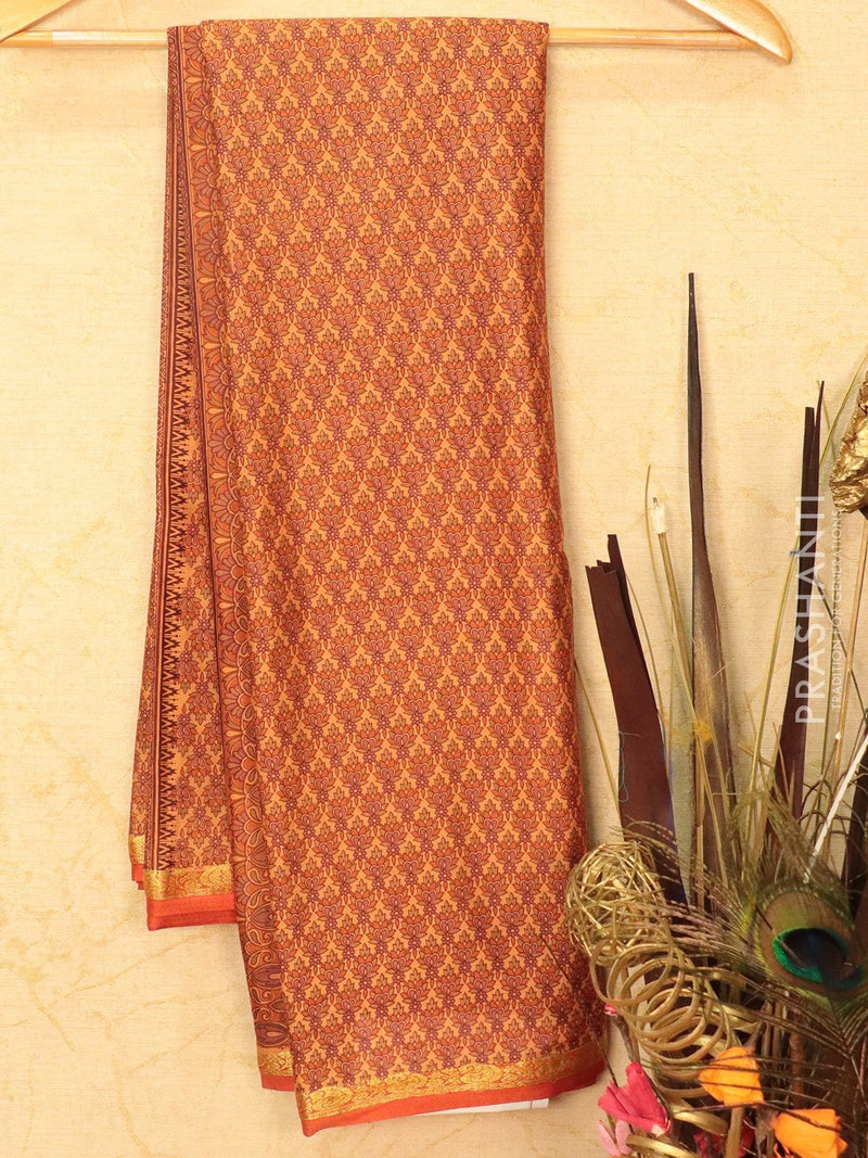 Semi crepe saree mild orange with all over prints and zari border