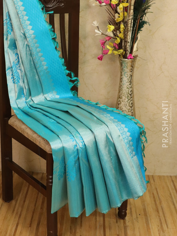Pure Kanjivaram silk saree light blue silver tissue with allover floral and peacock zari weaves with zari border