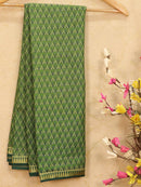Semi crepe saree pastal green and green with all over prints and zari border