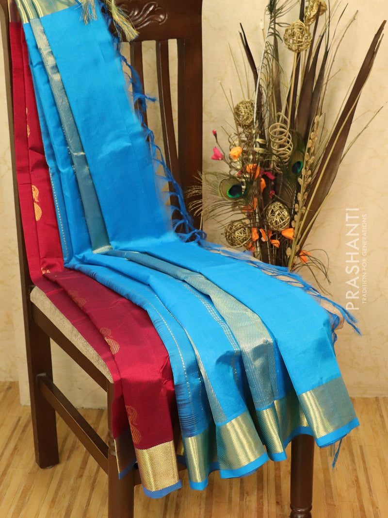 Silk cotton saree maroon and cs blue with zari woven buttas and border