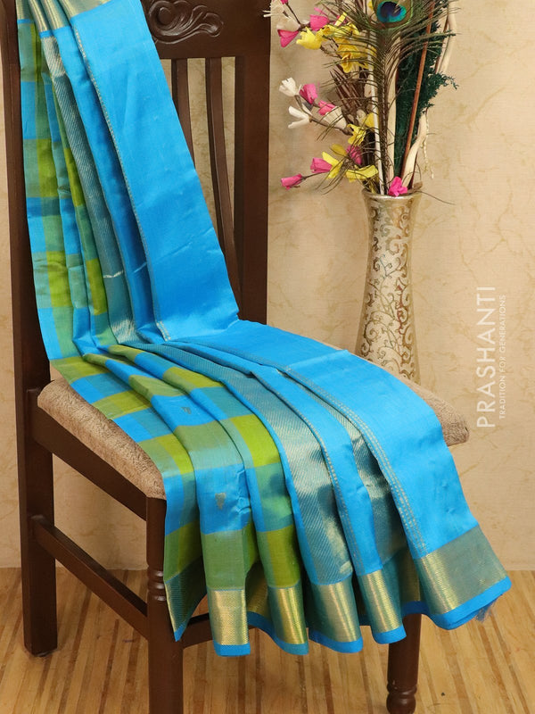 Silk cotton saree lime green and cs blue paalum pazhamun checks with zari woven butta and border