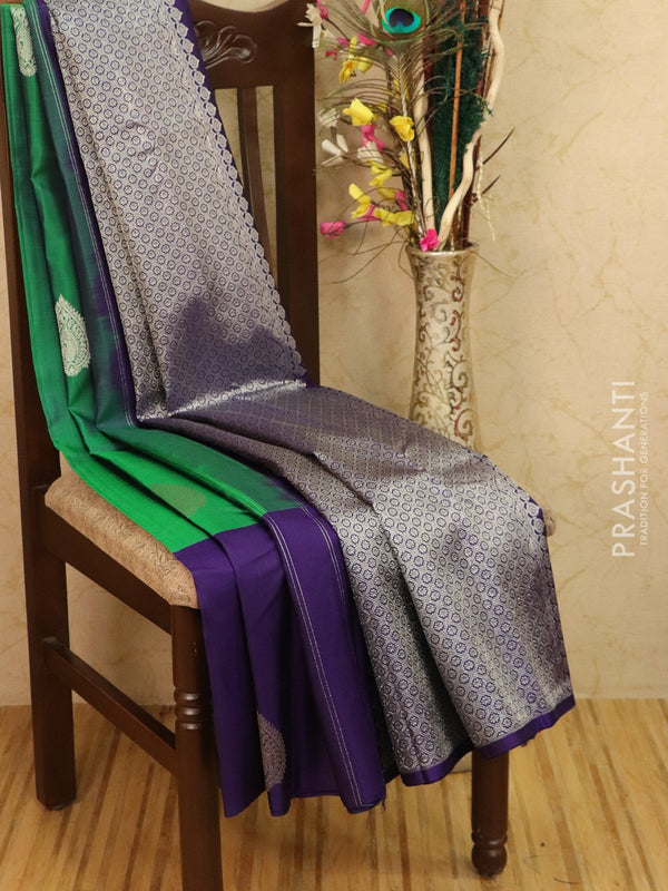 Pure kanjivaram silk saree green and violet with zari woven buttas in half and half style