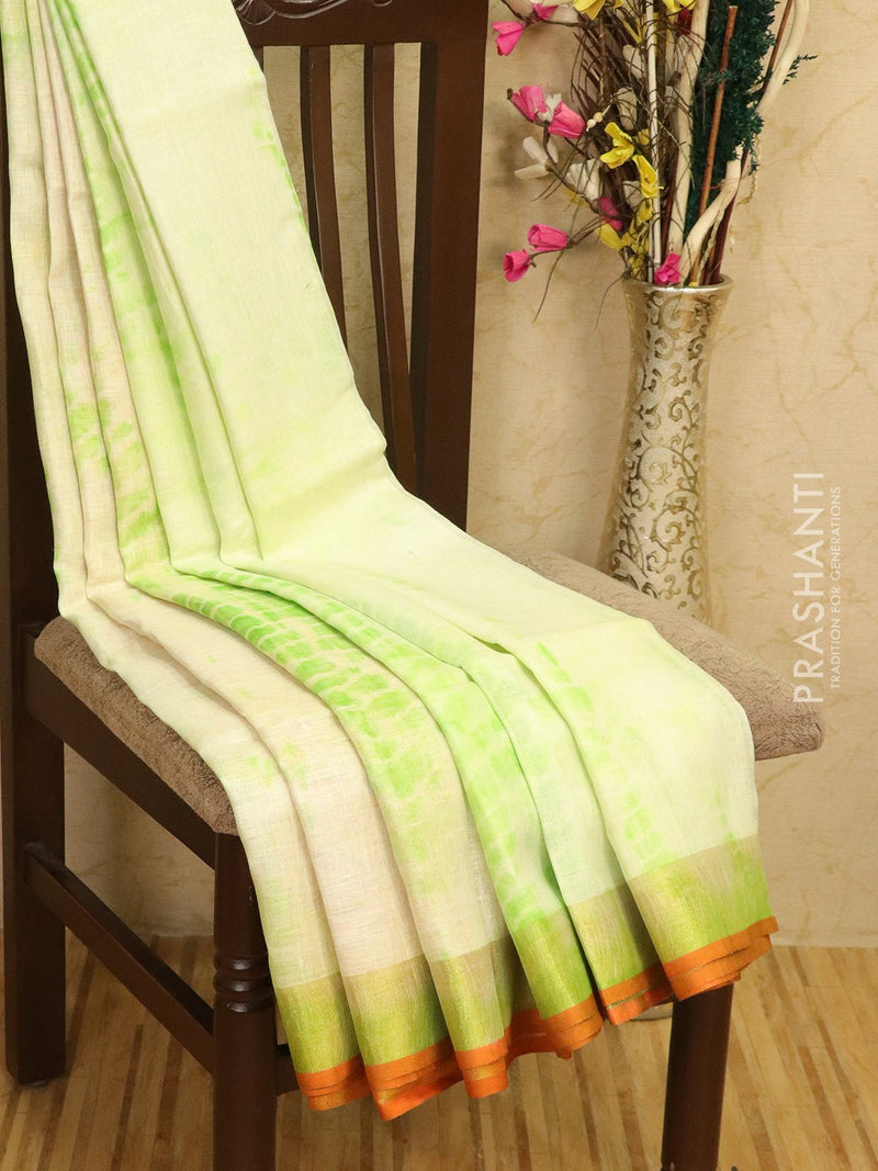 Pure linen saree offwhite and green with batik prints and simple border