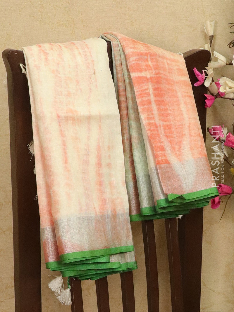 Pure linen saree cream and orange with batik prints and simple border