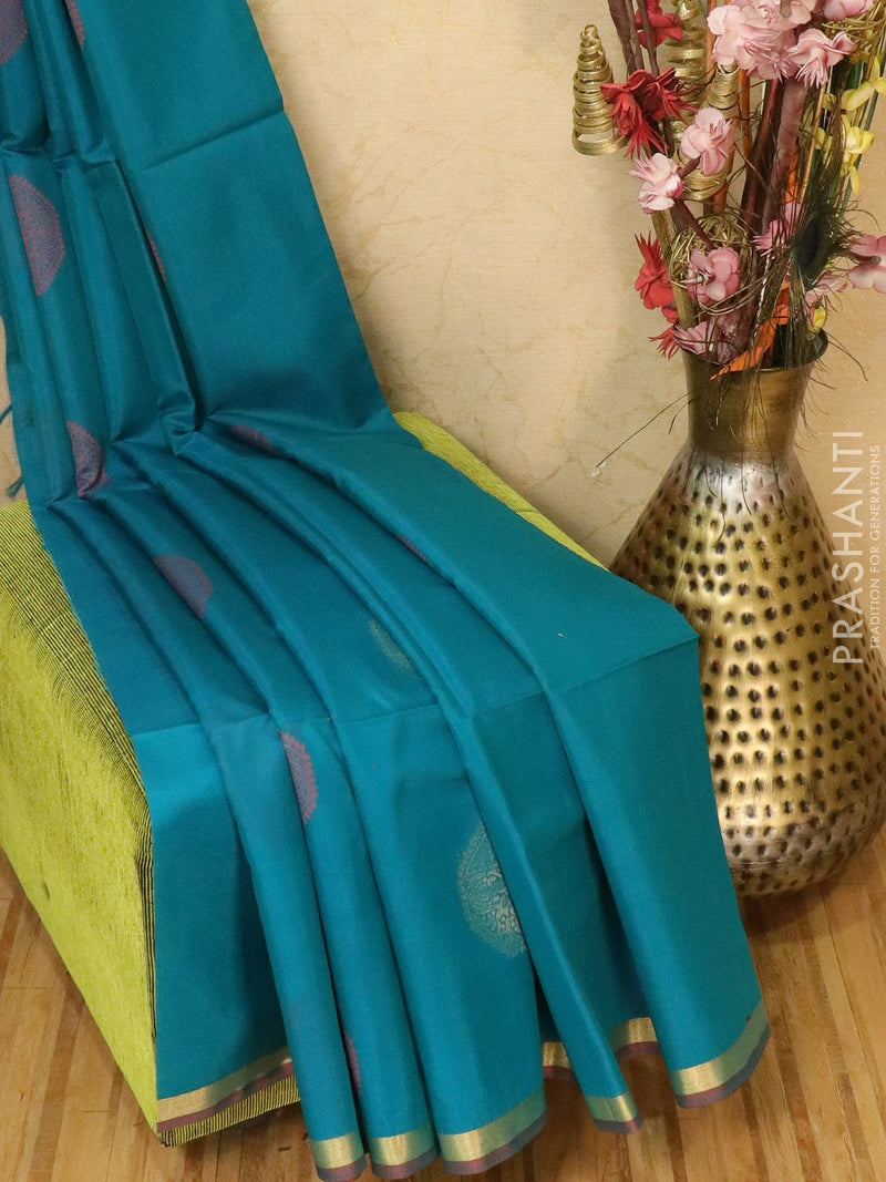 Kora silk cotton saree peacock blue with thread and zari woven buttas and simple zari border