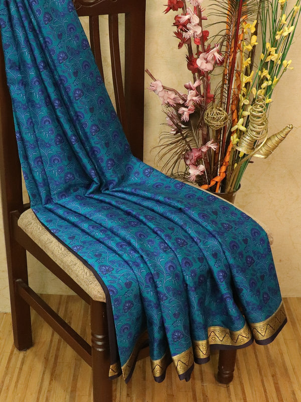 Pure Mysore Crepe silk saree peacock green and navy blue with allover prints and zari woven border