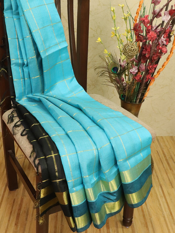 Silk cotton partly saree blue and black with zari checks and rettapet border