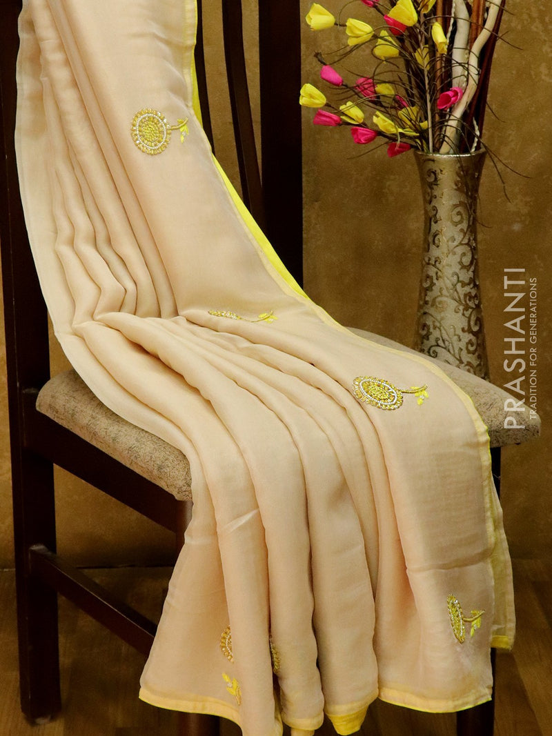 Jute georgette saree cream and yellow with floral hand embroided and piping border