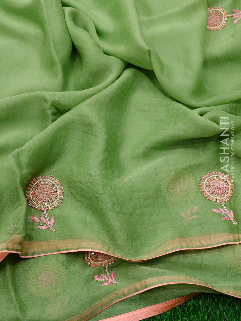 Jute georgette saree pastal green and peach pink with floral hand embroided and piping border