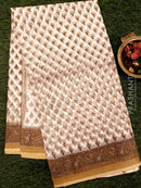Kota Doria saree white and beige with all over floral printas and simple zari border