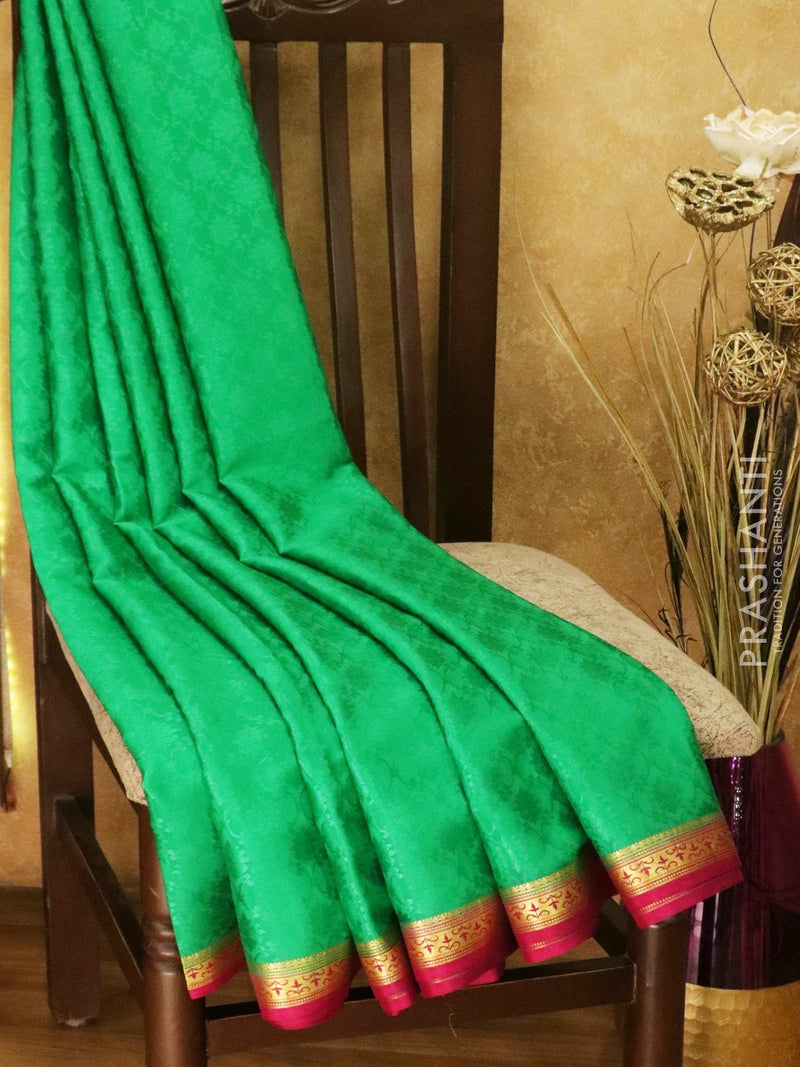 Mysore Crepe Silk Saree green and pink with allover self emboss and golden zari border