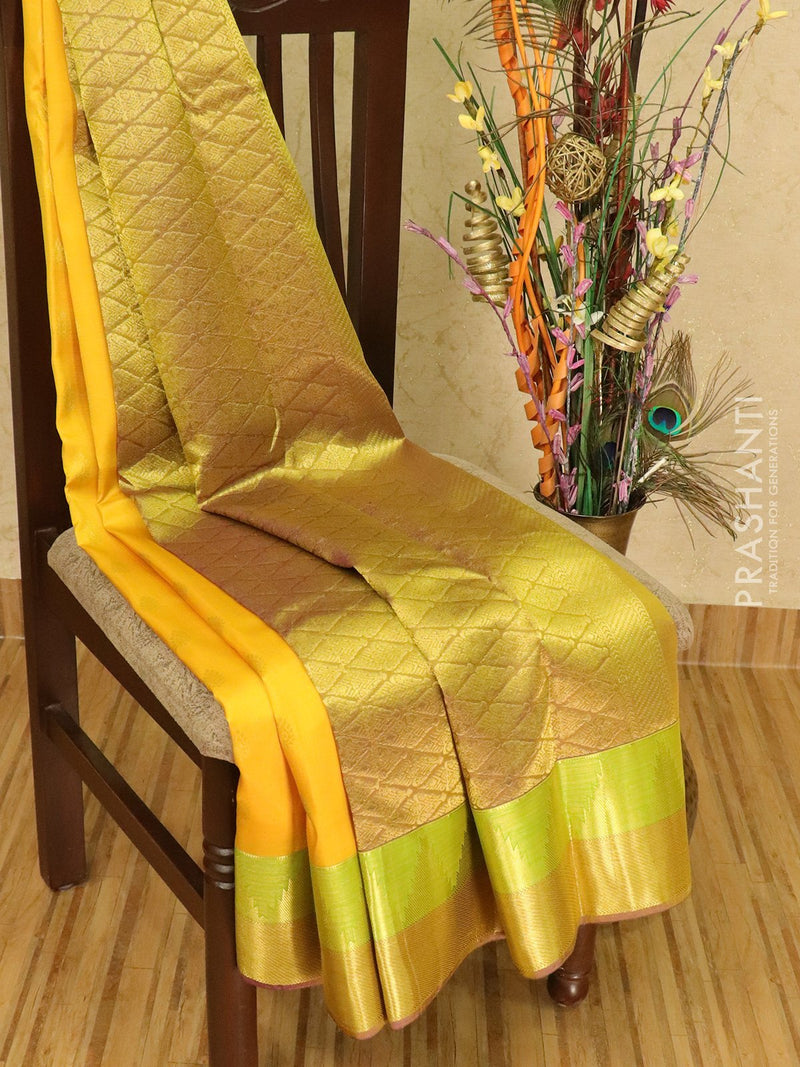 Pure kanchivaram silk saree yellow and dual shade of violet with zari woven buttas and rich zari woven border