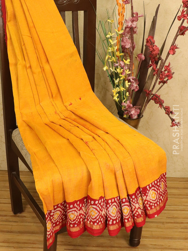 Chanderi bagru saree mango yellow and red with batik prints and small zari border