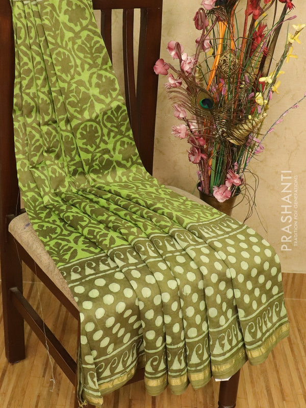 Chanderi bagru saree green with dabu prints and small zari border