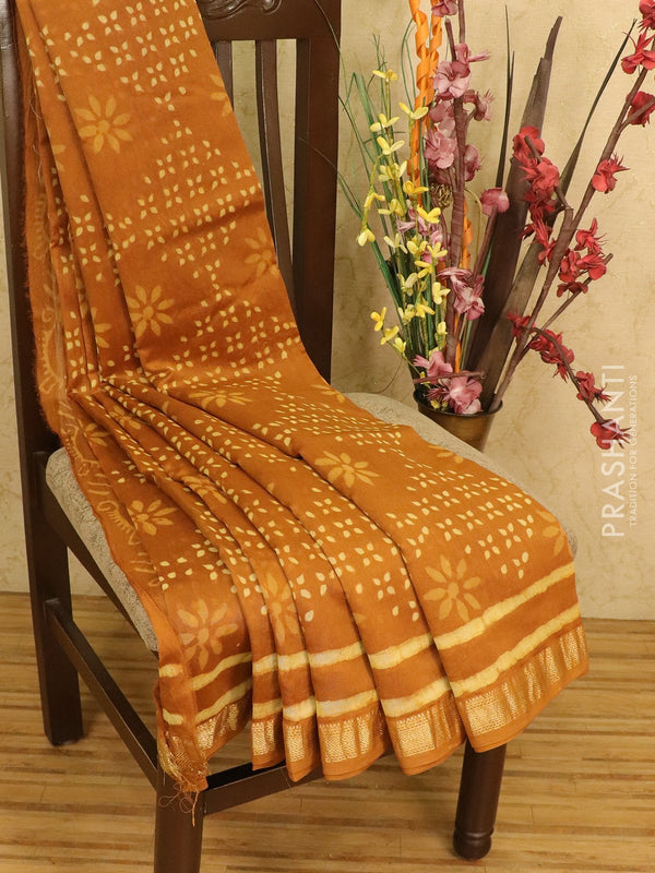 Chanderi bagru saree mustard with allover floral prints and maheswari border