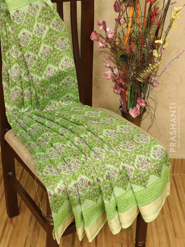 Chanderi bagru saree pista green with allover floral prints and maheswari border