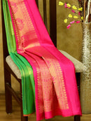 Pure Kanjivaram silk saree green and pink with golden zari lines and paisley buttas in borderless style