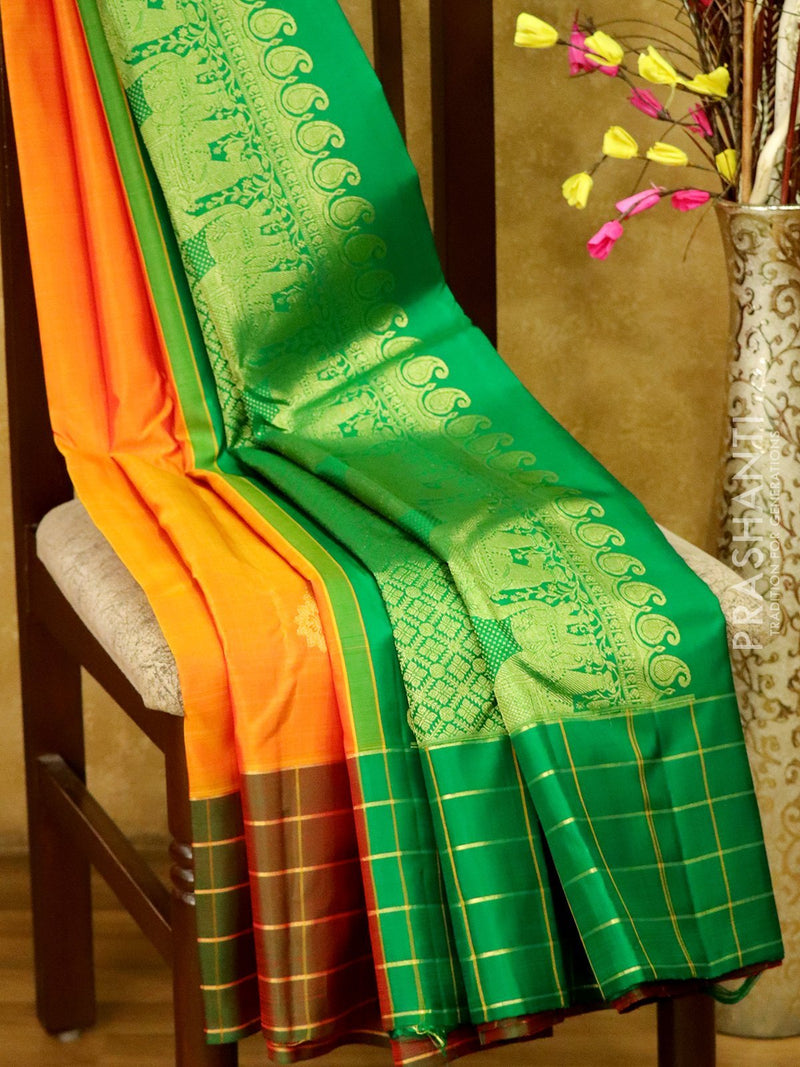 Pure Kanjivaram silk saree golden yellow and green with golden zari paisley motifs and zari checked border