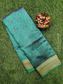 Semi raw silk saree dual shade of pink and green with allover self emboss and zari woven border
