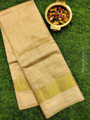 Semi raw silk saree beige with self emboss and zari border