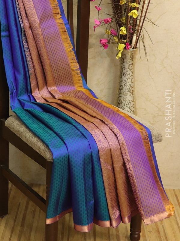 Pure kanjivaram silk sareee peacock blue with piping zari border and self emboss body