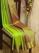 Pure kanjivaram silk sareee lime green and magenta with traditional zari border