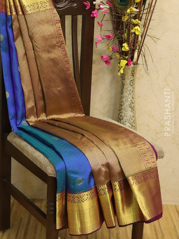 Pure kanjivaram silk sareee peacock blue and magenta with self emboss and rich zari border