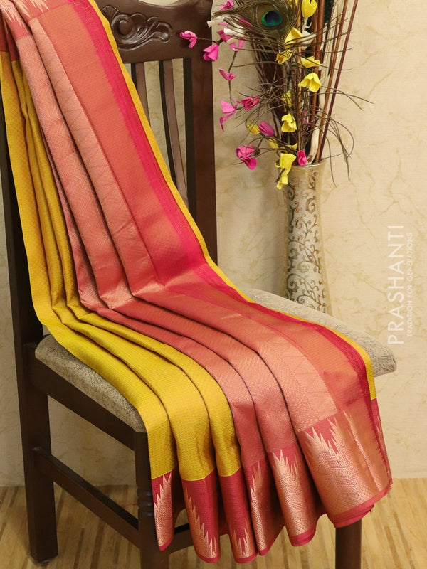 Pure kanjivaram silk sareee mustard and pink with allover self emboss and rich zari woven temple border