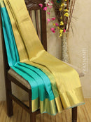 Pure kanjivaram silk sareee teal blue and beige with allover self emboss and rich zari woven border