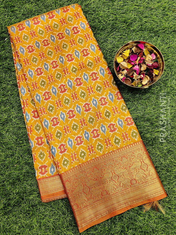 Semi Tussar saree mustard and rust with all over ikkat prints and rich zari woven border