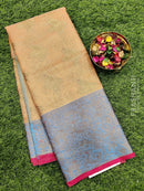 Banarasi tissue kora saree peach and blue with rich zari woven border