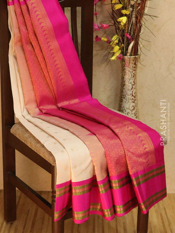 Pure kanjivaram silk sareee off white and pink with golden zari small buttas and rettapet border